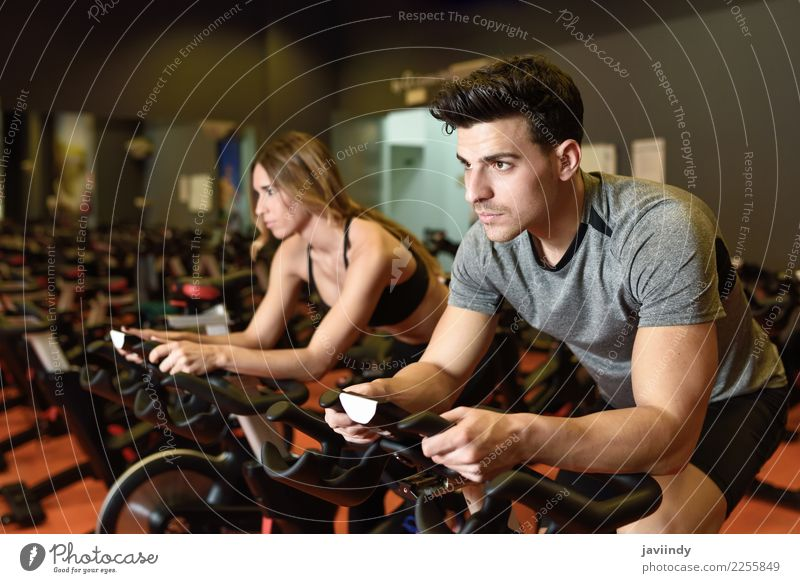 Couple in a spinning class wearing sportswear. Woman Human being Youth (Young adults) Man Young woman Young man 18 - 30 years Adults Lifestyle Sports Feminine