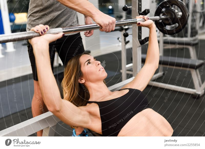 Personal trainer motivating a young woman lift weights Lifestyle Body Sports Human being Masculine Young woman Youth (Young adults) Young man Woman Adults Man 2