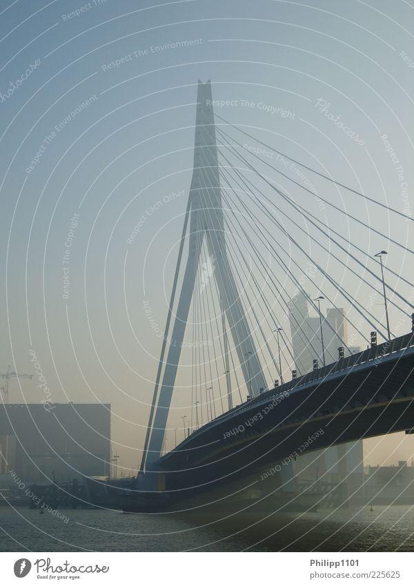 City Architecture Esthetic Bridge River Manmade structures Skyline Downtown Tourist Attraction Blue sky Haze Gigantic Suspension bridge Rotterdam