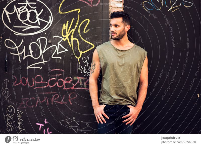 young handsome man with t-shirt against a wall in street Lifestyle Style Happy Human being Boy (child) Man Adults Town Street Fashion Jeans Cool (slang)
