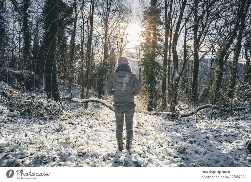 Young woman in a snow-covered forest looking into the sun Body Healthy Life Vacation & Travel Tourism Trip Winter vacation Hiking Feminine Youth (Young adults)
