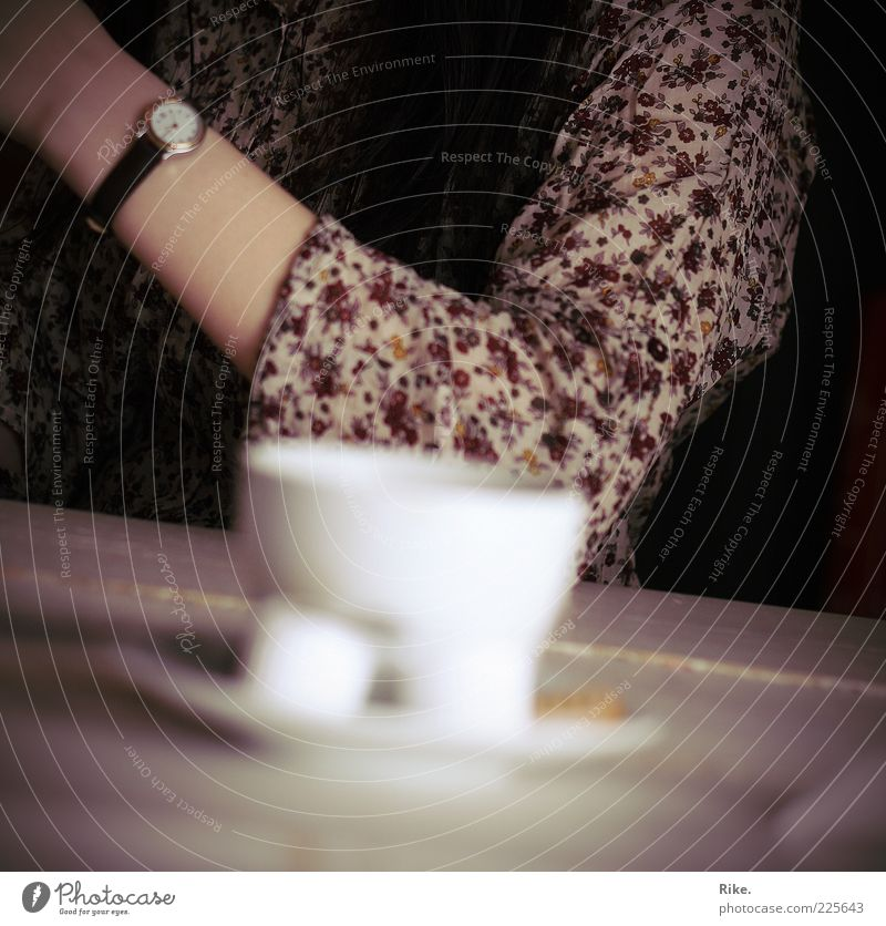 Coffee break. To have a coffee Beverage Hot drink Tea Cup Table Drinking Café Human being Arm 1 Wristwatch Brunette Long-haired Relaxation To enjoy Communicate