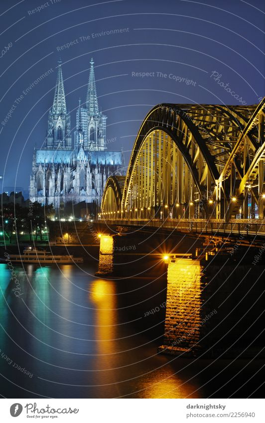 Cologne Night Vertical Water Summer River Rhine Cologne Cathedral Hohenzollern Bridge Federal eagle Europe Town Downtown Old town Dome Manmade structures