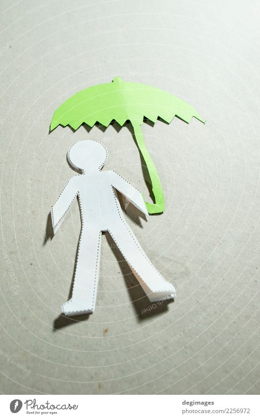 Fugire of men and umbrella Human being Man Adults Hand Weather Rain Paper Under Green Black White Safety Protection Insurance people cutout Cut Figure