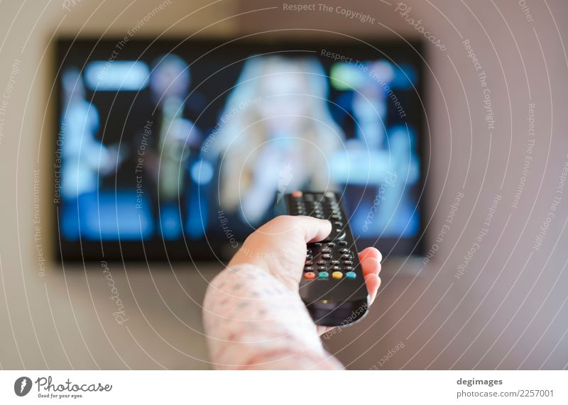 TV and hand hold remote control. Life Relaxation Leisure and hobbies Entertainment Screen Technology Human being Hand Media Television Observe Smart