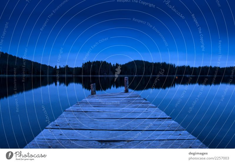 Pier on a lake in the night Vacation & Travel Summer Sun Mountain Nature Landscape Sky Horizon Tree Forest Lake Wood Old Blue Peace Idyll Jetty water tranquil