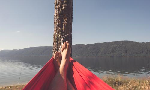 Man in hammock on mountain lake Human being Nature Vacation & Travel Summer Green Tree Relaxation Mountain Adults Lifestyle Boy (child) Happy Lake Sleep Camping