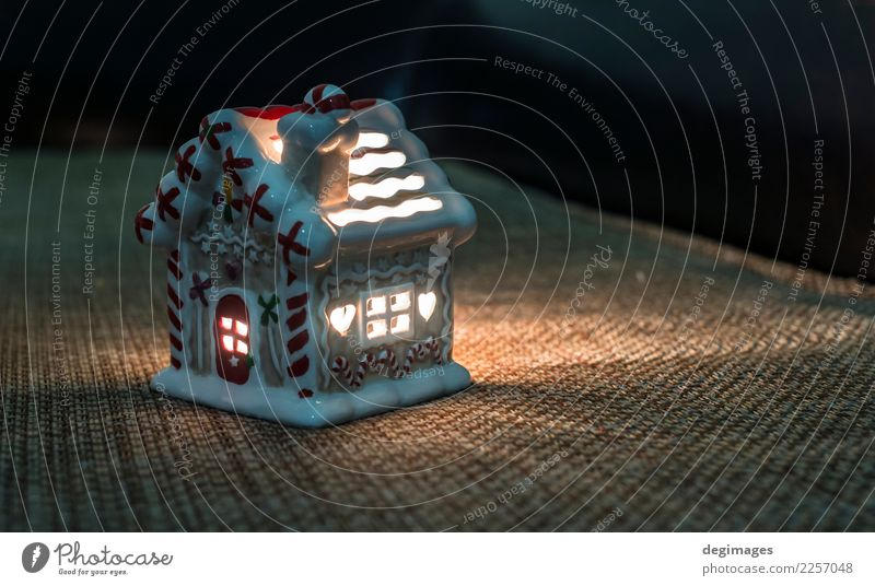 Christmas house. Candle light in the house. Winter Snow House (Residential Structure) Decoration Feasts & Celebrations Christmas & Advent Facade Dark Bright