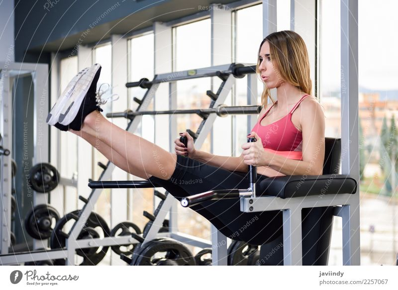 Young fit woman at the gym doing abs workout Lifestyle Beautiful Body Sports Human being Feminine Young woman Youth (Young adults) Woman Adults 1 18 - 30 years