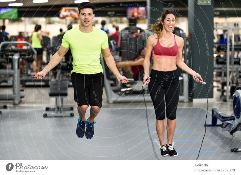 Young man and woman workout with jumping rope Woman Human being Youth (Young adults) Man Young woman Beautiful White Joy Adults Lifestyle Funny Sports Feminine