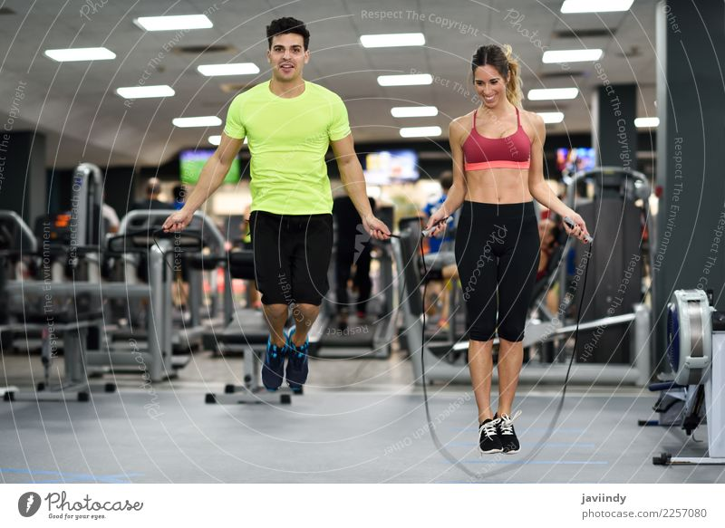 Young man and woman workout with jumping rope Lifestyle Joy Happy Beautiful Sports Rope Human being Masculine Feminine Young woman Youth (Young adults) Woman