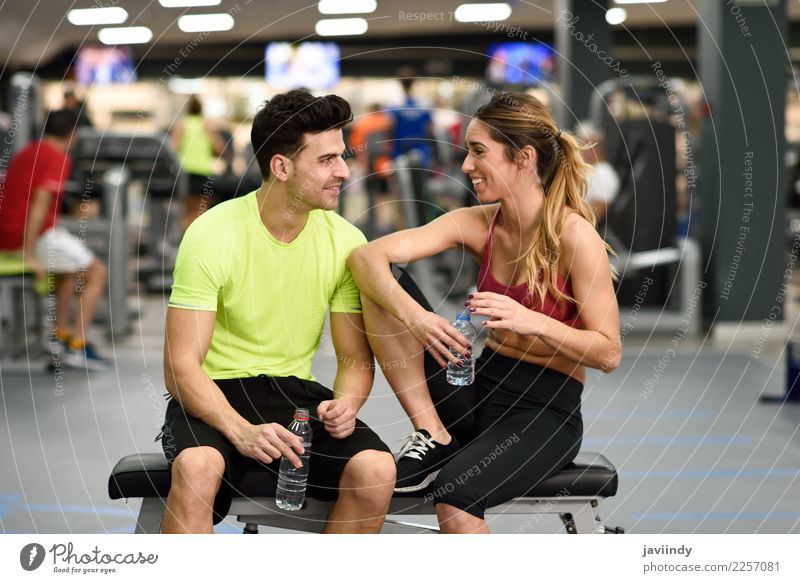 Man and woman personal trainers in the gym. Woman Human being Youth (Young adults) Young woman Young man White 18 - 30 years Adults Lifestyle To talk Sports