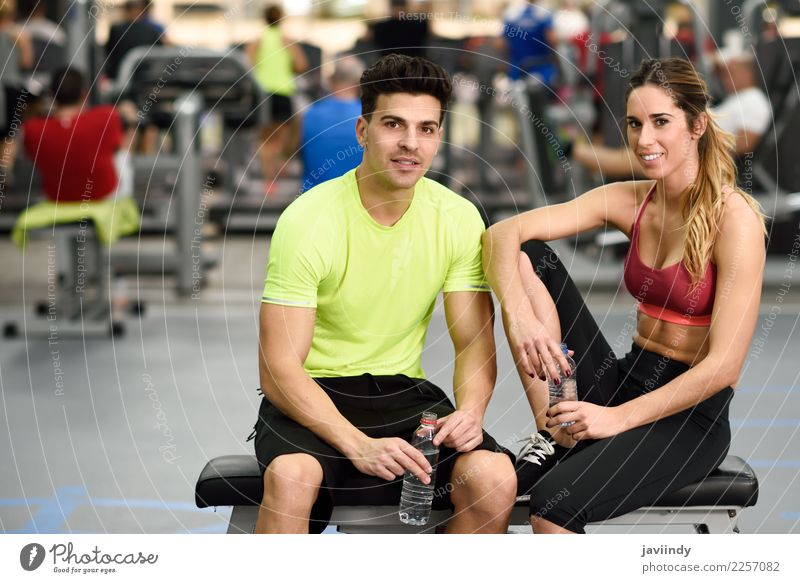 Man and woman personal trainers in the gym. Drinking Bottle Lifestyle Happy Body Wellness Sports To talk Human being Masculine Feminine Young woman