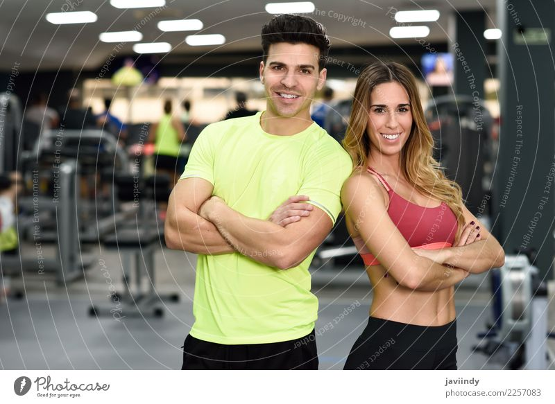 Man and woman personal trainers in the gym. Lifestyle Happy Beautiful Body Sports Human being Masculine Feminine Young woman Youth (Young adults) Young man
