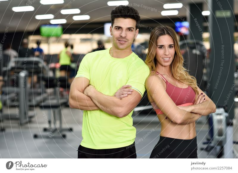 Man and woman personal trainers in the gym. Woman Human being Youth (Young adults) Young woman Beautiful Young man White 18 - 30 years Adults Lifestyle Sports