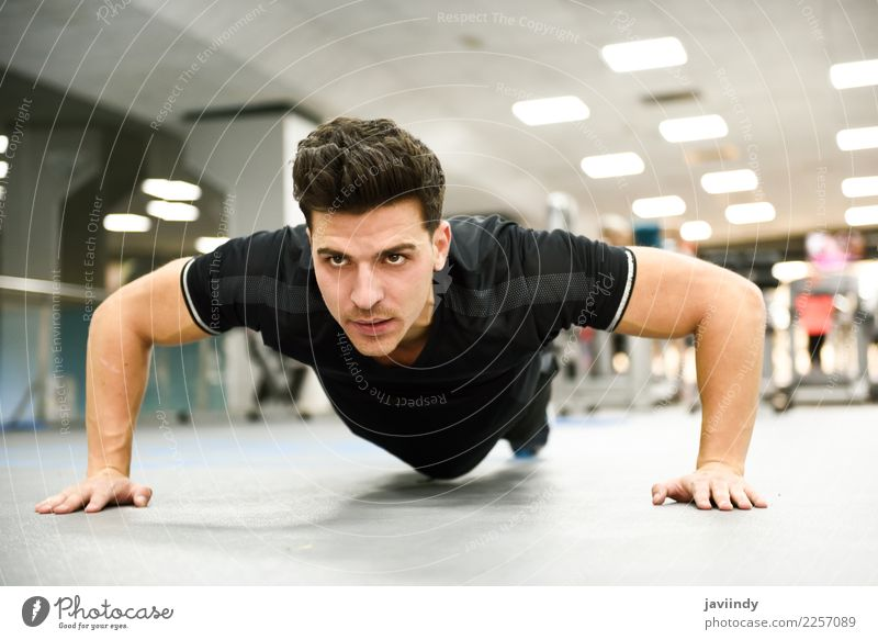 Attractive man doing pushups in the gym. Lifestyle Beautiful Body Sports Human being Young man Youth (Young adults) Man Adults 1 18 - 30 years Fitness Thin