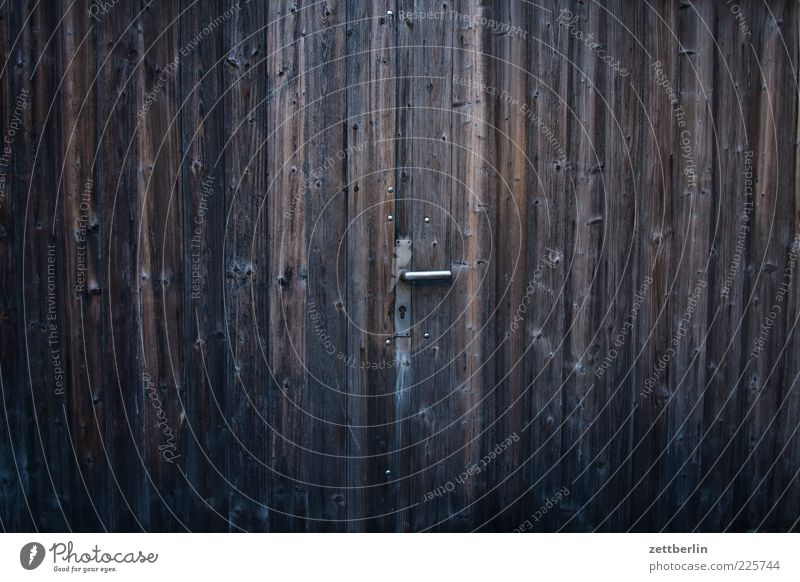 gate Door Old Door handle Wood Wooden gate Garage Entrance Way out Scales Colour photo Exterior shot Deserted Copy Space left Copy Space right Copy Space top