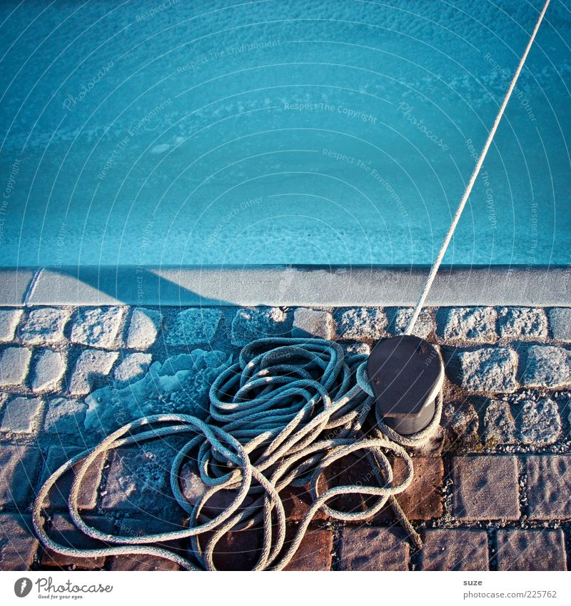 Blue Water Ocean Cold Ice Rope Frost To hold on Lakeside Harbour Jetty Cobblestones Paving stone Ground Attach Bollard