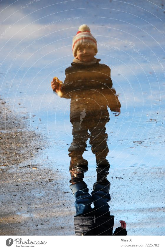 Human being Child Sky Water Joy Winter Cold Playing Boy (child) Autumn Emotions Coast Rain Contentment Dirty Wet