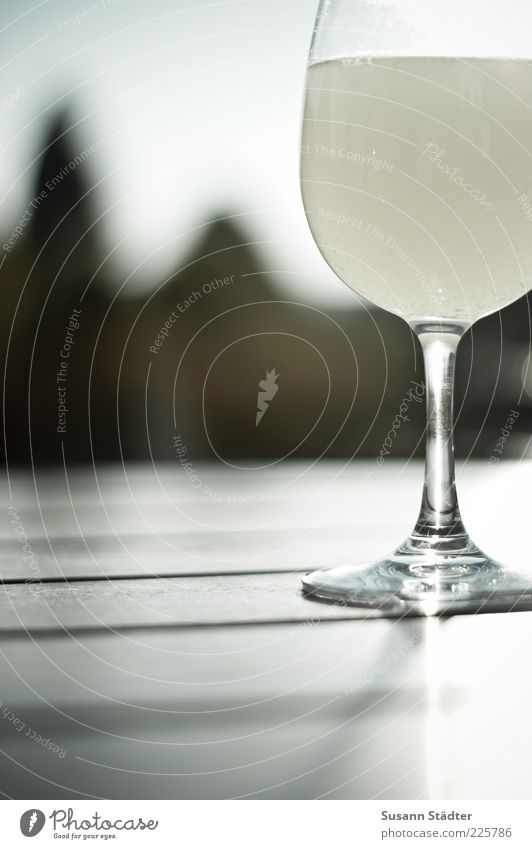 0,2 Beverage Lemonade Wine Sparkling wine Prosecco Fluid Alcoholic drinks Wine glass Wooden table Summery Exterior shot Close-up Detail Reflection