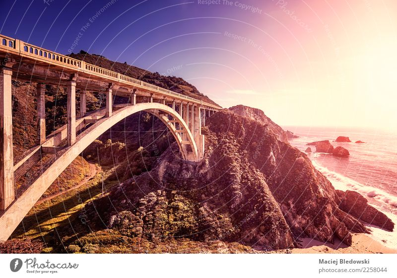 Bixby Creek Bridge at sunset, California, USA. Vacation & Travel Trip Summer Summer vacation Sun Beach Ocean Mountain Landscape Climate Rock Coast Exceptional