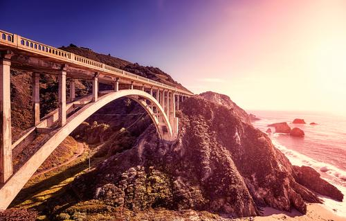 Bixby Creek Bridge at sunset, California, USA. Vacation & Travel Summer Beautiful Landscape Sun Ocean Relaxation Beach Mountain Coast Exceptional Moody Rock