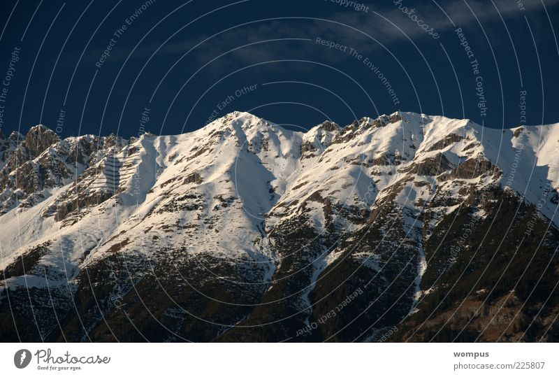 Sky Nature White Blue Winter Far-off places Snow Mountain Landscape Gray Rock Alps Peak Beautiful weather Snowcapped peak