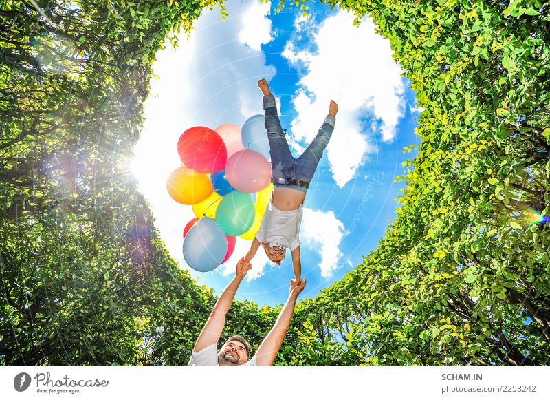 Dad circling his son high above his own head. Ballons Child Human being Sky Man Plant Blue Summer Beautiful Green White Landscape Joy Adults Life Lifestyle Love
