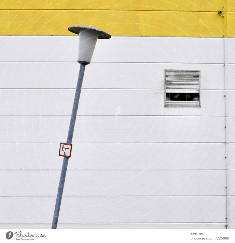 slanting position Factory Manmade structures Architecture Wall (barrier) Wall (building) Concrete Sign Yellow White Lamp Lantern Lamp post Street lighting