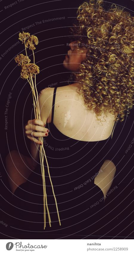 Studio portrait. Back view of a thin blonde woman Elegant Style Design Beautiful Body Hair and hairstyles Skin Harmonious Senses Relaxation Calm Human being