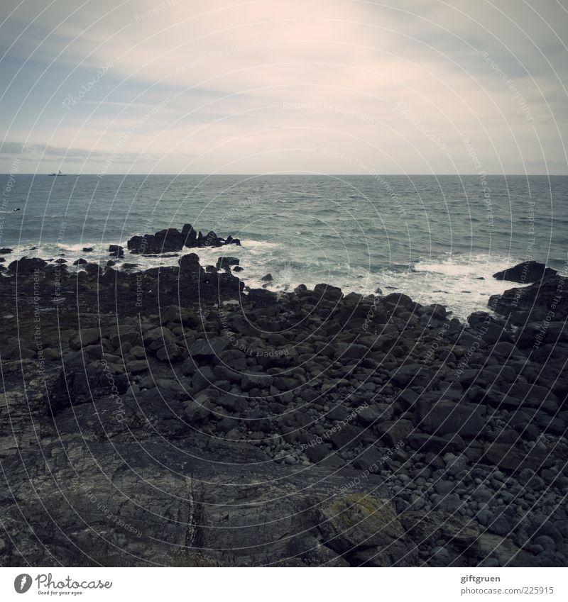 Sky Nature Water Beach Ocean Clouds Far-off places Dark Environment Landscape Stone Coast Waves Earth Wind Horizon