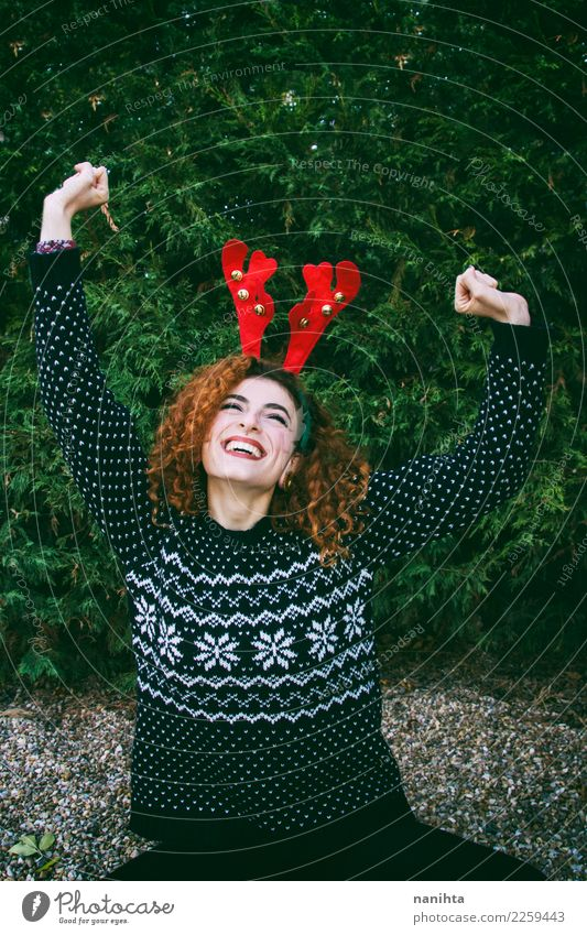 Young redhead woman enjoying a christmas day Human being Nature Youth (Young adults) Christmas & Advent Young woman Tree Joy 18 - 30 years Adults Life Lifestyle