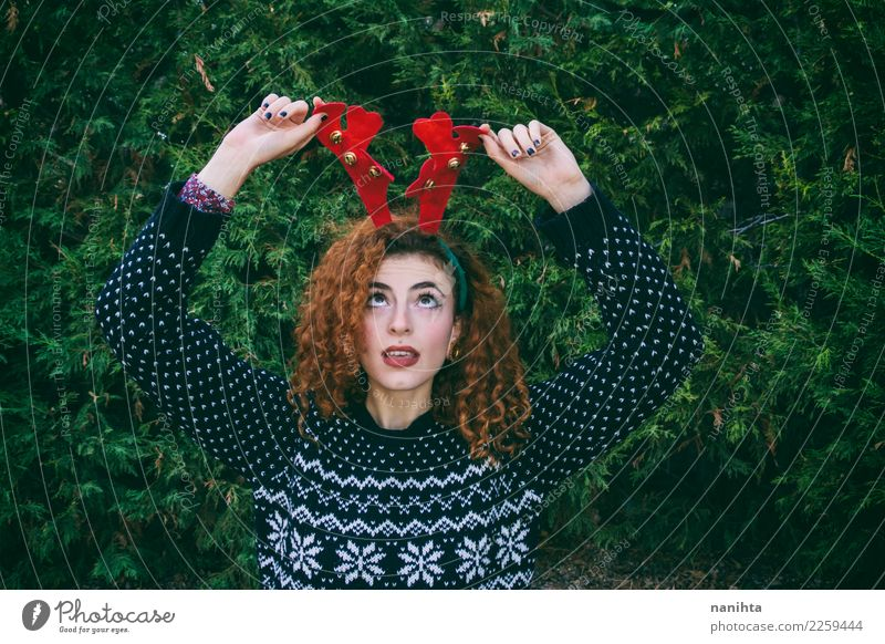 Young woman making a funny face at christmas Style Design Joy Feasts & Celebrations Christmas & Advent New Year's Eve Human being Feminine Youth (Young adults)