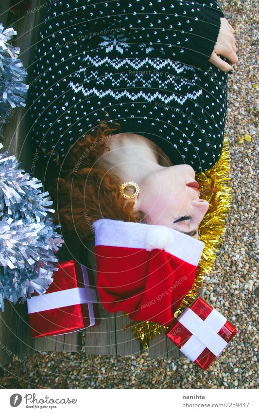 Young woman sleeping rounded by christmas decorations Human being Youth (Young adults) Christmas & Advent Beautiful 18 - 30 years Face Adults Lifestyle Feminine