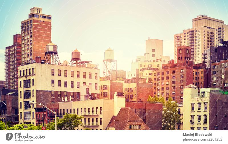 Old residential buildings in New York City at sunset, USA. Town House (Residential Structure) Architecture Building Facade Moody Living or residing