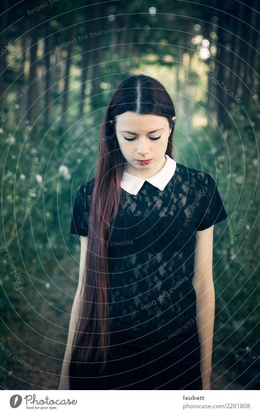 Portrait of a young woman in a melancholic mood, in a forest Human being Nature Youth (Young adults) Young woman Landscape Loneliness Forest 18 - 30 years