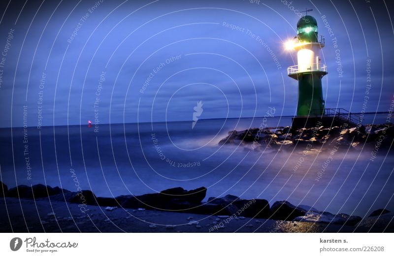 Light signals II Bad weather Wind Gale Fog Baltic Sea Port City Lighthouse Navigation Harbour Water Illuminate Blue Cold Colour photo Exterior shot Evening