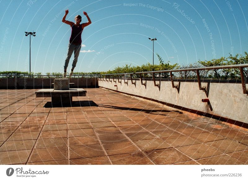 find me in the world Departure Superman Shadow Human being Woman Sun Plant Terrace Balcony Sky Summer Paving stone Cobblestones Stone Jump Blue sky Lamp post
