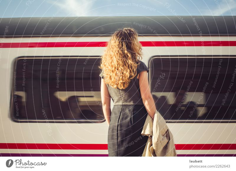 Young woman waiting for a train - Horizontal view Woman Vacation & Travel Town Far-off places Adults Lifestyle Tourism Trip Transport Retro Adventure Wait