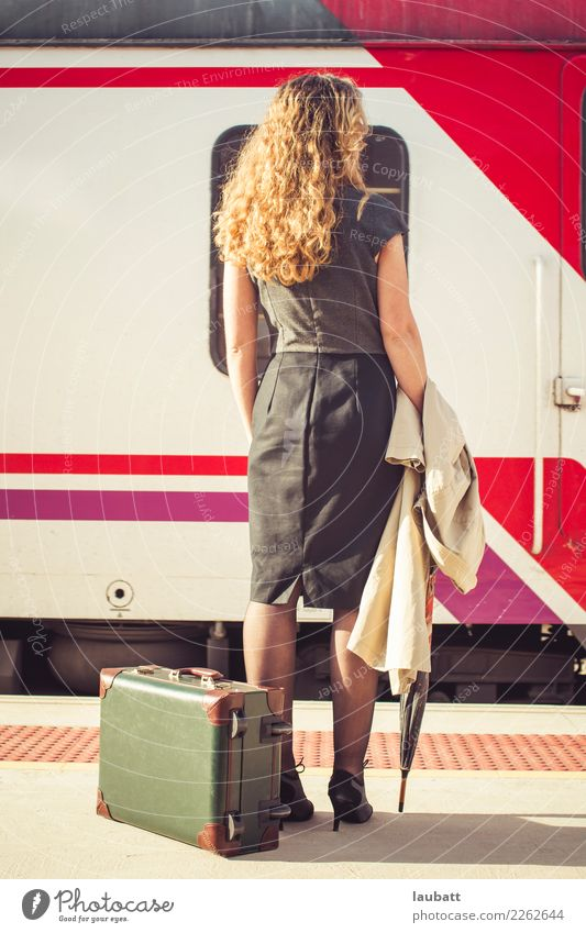 Young woman waiting for a train - Vertical view Woman Vacation & Travel Town Far-off places Adults Lifestyle Tourism Trip Transport Adventure Wait Observe