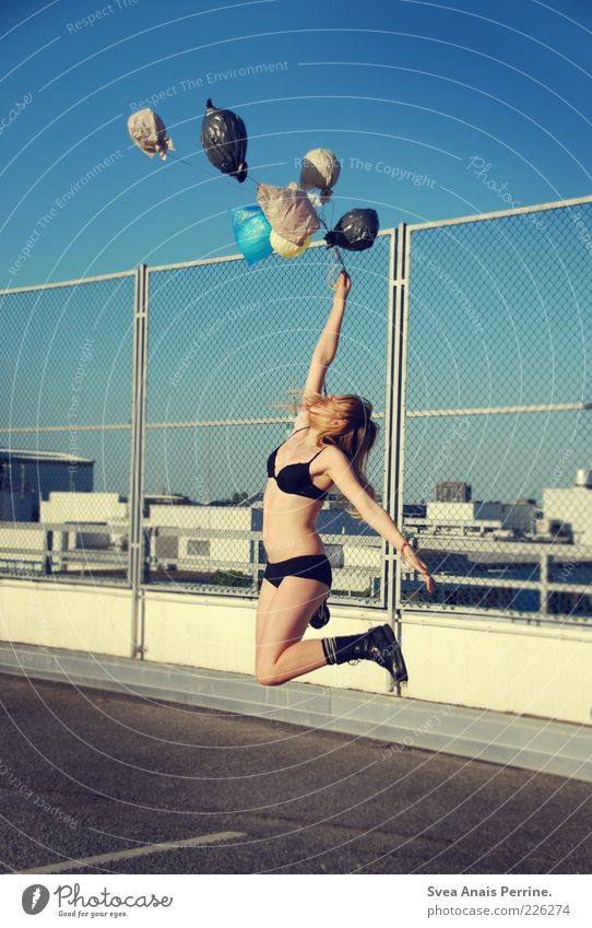 Human being Youth (Young adults) Beautiful Joy Adults Feminine Freedom Jump Happy Concrete Tall 18 - 30 years Balloon Desire Young woman Asphalt
