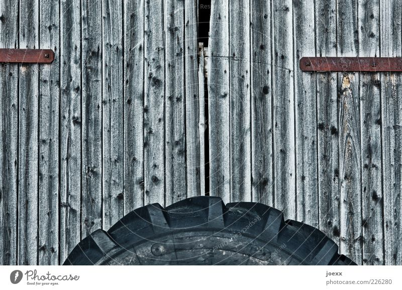 Mobile barn Hut Door Wood Old Gray Black Barn door Tire Colour photo Subdued colour Pattern Deserted Day Wide angle