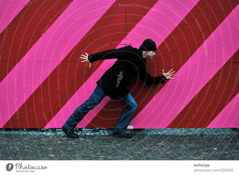- step - Human being Masculine Man Adults 1 30 - 45 years Coat Cap Looking Pink Red Line Fence Going Dynamics Hoarding Colour photo Day Full-length Adjustment