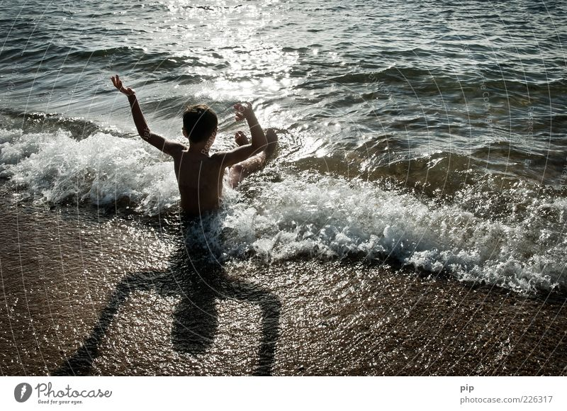 well-wet Human being Boy (child) Infancy Arm 1 Nature Sand Water Summer Beautiful weather Waves Coast Beach Ocean Swimming & Bathing Wait Happiness Wet Joy