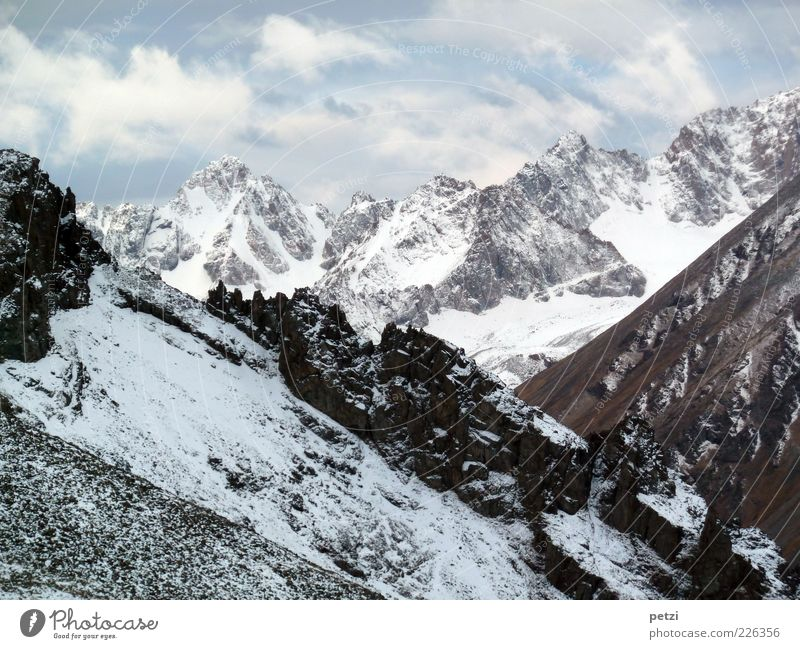 Sky Nature White Blue Winter Loneliness Far-off places Black Snow Mountain Environment Landscape Gray Stone Brown Rock