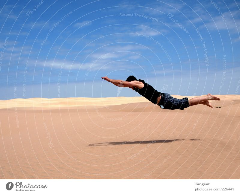 Hard landing Vacation & Travel Freedom Masculine Young man Youth (Young adults) 1 Human being Sand Desert Flying Jump Athletic Joie de vivre (Vitality)