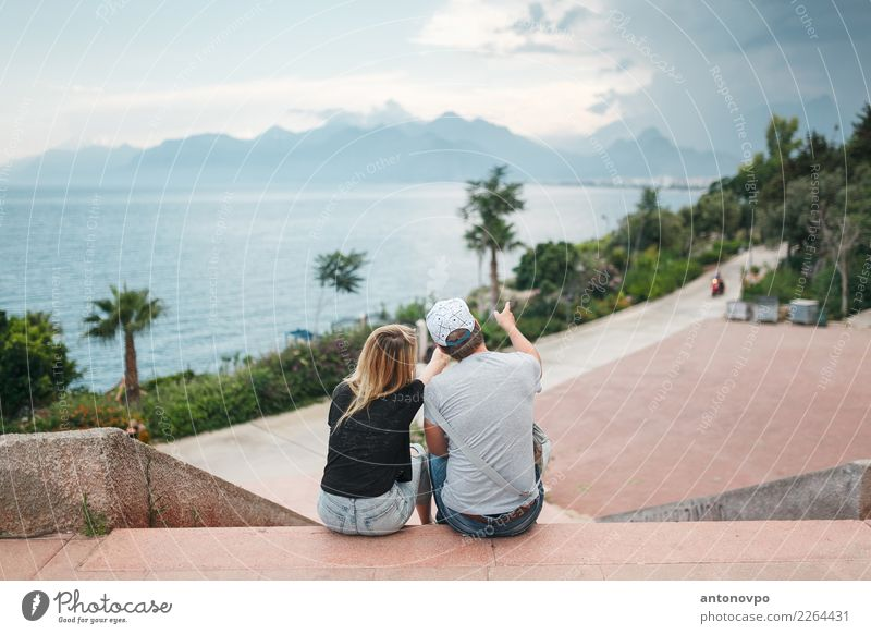 couple on the promenade Lifestyle Tourism Trip Far-off places Freedom City trip Summer Summer vacation Beach Island Human being Young woman Youth (Young adults)