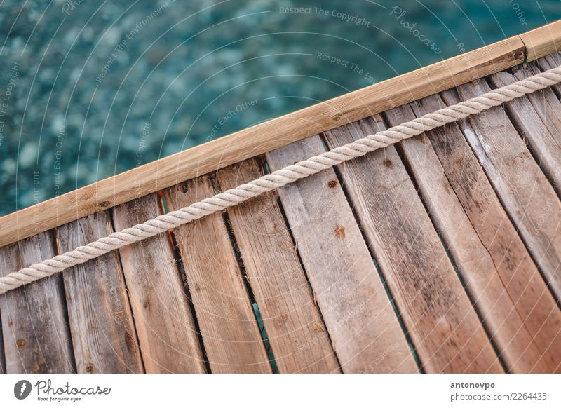 pier board rope Water Beach Blue Yellow Rope Board Jetty Wood Texture of wood wooden Colour photo