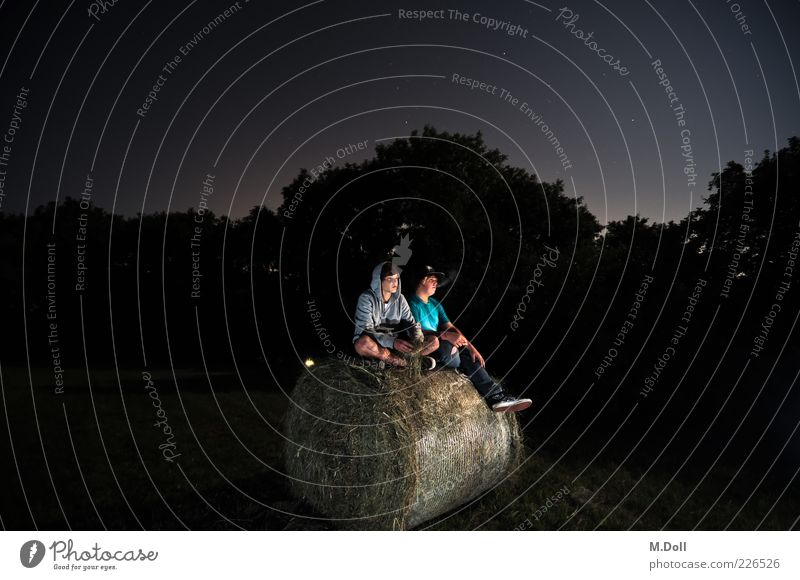 hay bales Human being Masculine Friendship Youth (Young adults) 2 Clothing Relaxation Smoking Sit Colour photo Exterior shot Evening Flash photo Light