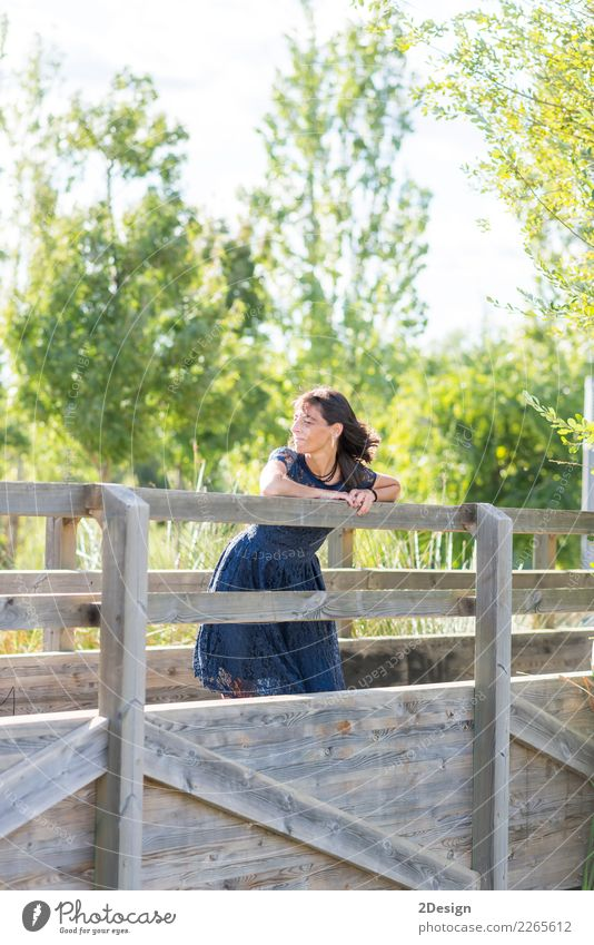 Portrait of a sensual woman on a wooden bridge Woman Human being Sky Nature Vacation & Travel Blue Summer Beautiful White Loneliness Calm Adults Lifestyle Wood